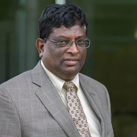 Professional headshot of Herman Dharmarajah