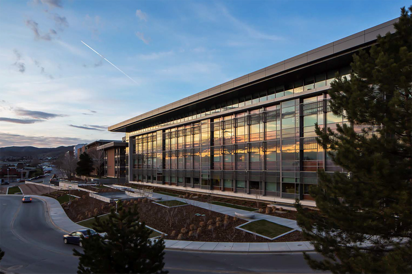 The final façade of L.S. Skaggs Pharmacy Research Institute, reflecting the local landscape