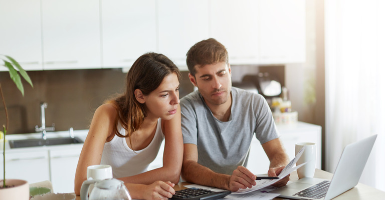 Couple looking at a laptop screen